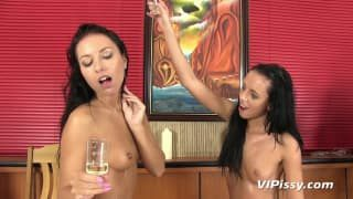 Two gorgeous lesbian babes get oiled and wet